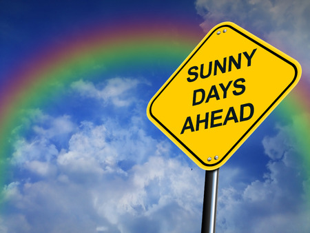 promising: Sunny Days Ahead Road Sign With Rainbow and Sky Background