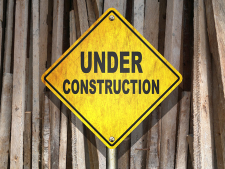under construction road sign: An illustration of under construction road sign with stacks of lumber in the background