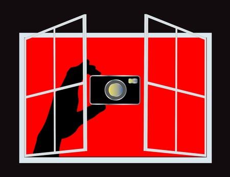 Mano que sostiene una cámara espía apuntando a algo o alguien de una ventana