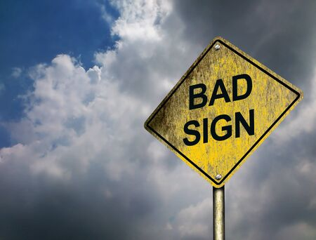 An illustration of Bad Sign Road Sign with threatening darkening clouds in the sky background (Copyspace)