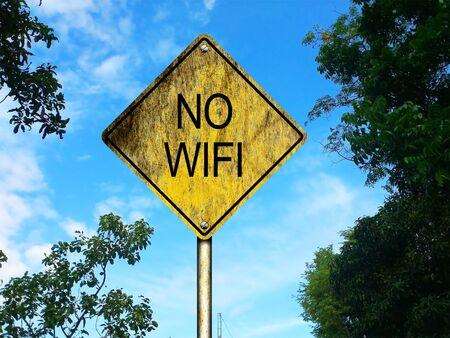 old sign: No Wifi Road Sign with a countryside background Stock Photo