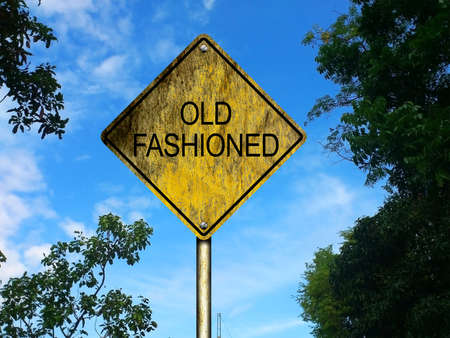 awkward: Old-fashioned old and weathered road sign with rustic countryside background