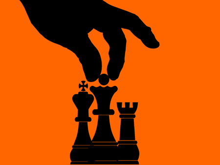 Chess move - master stroke - fingers hand moving a chess piece to make a very crucial move