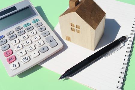 calculator home pen notebook green