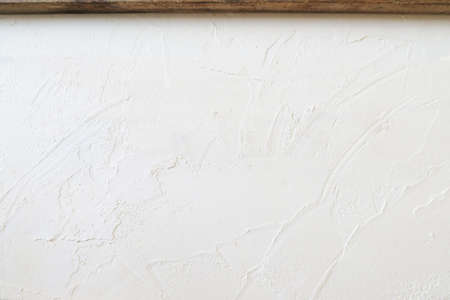 White wall texture and wood frame
