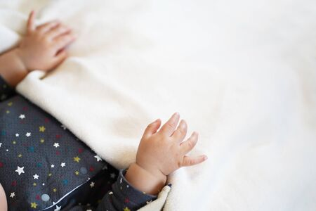 5 month old baby hands and blankets 写真素材