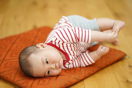 5 month old baby crawling in the living room