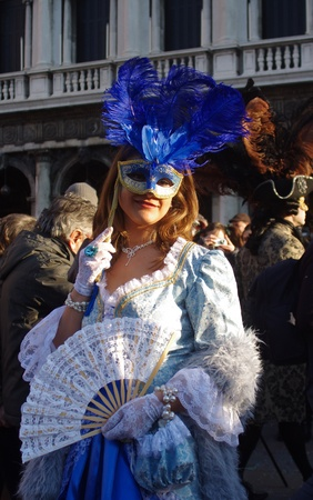 Venice, Italy - February 21, 2012 - Participants of the traditional Venetian carnival masks are photographed on the streets of the city