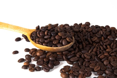 Coffee cup and beans on old kitchen table. Top view with copyspa Stock Photo