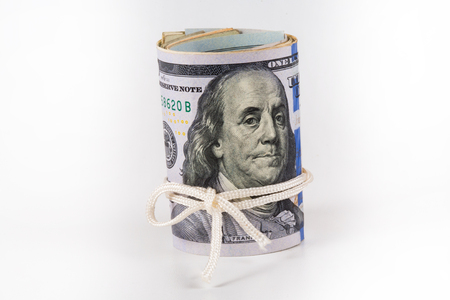 The dollar, a model on a dollar bill, a concept and idea of cost and money in time, real state commercial and financial concepts, symbol of the bank, the storage of money. Stock Photo