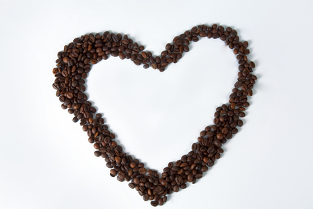 Coffee cup and beans on old kitchen table. Top view with copyspace for your text Standard-Bild