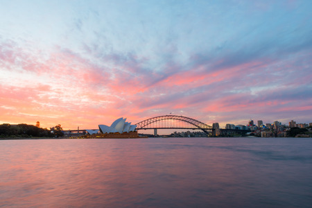 jorn: Sydney Opera House and Harbour Bridge at sunset. Sep,11,2016.The Sydney Opera House,Sydney,NSW,Australia.It was designed by Danish architect Jorn Utzon, finally opening in 1973.