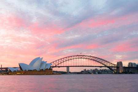 danish: Sydney Opera House and Harbour Bridge at sunset. Sep,11,2016.The Sydney Opera House,Sydney,NSW,Australia.It was designed by Danish architect Jorn Utzon, finally opening in 1973.