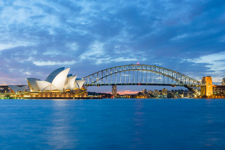 Long exposure Sydney Opera House and Harbour Bridge at night . Sep,13,2016.The Sydney Opera House,Sydney,NSW,Australia.It was designed by Danish architect Jorn Utzon, finally opening in 1973. Editorial