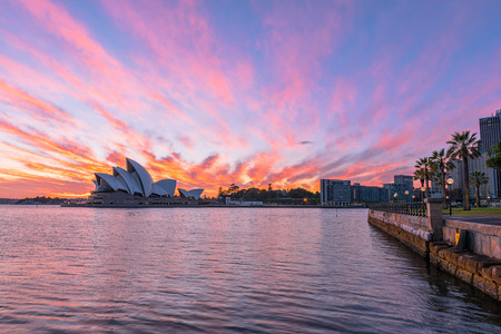 wales: Sydney Opera House at sunrise in Sydney Australia.NOV 11,2016 The Sydney Opera House is a famous arts center.Over 10 millions tourists visit Sydney a year.
