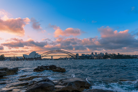 jorn: View of  Sydney Opera House And Harbour Bridge at sunset from Mrs macquries Chair.NOV 28,2016 The Sydney Opera House is a famous arts center. It was designed by Danish architect Jorn Utzon, finally opening in 1973.