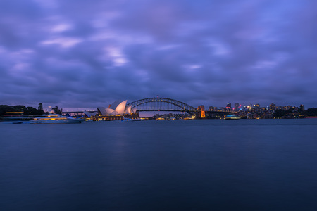 View of  Sydney Opera House And Harbour Bridge at sunset from Mrs macquries Chair.NOV 28,2016 The Sydney Opera House is a famous arts center. It was designed by Danish architect Jorn Utzon, finally opening in 1973.