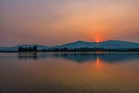 Sunset on mountain lake in Chiang Rai,North of Thailand
