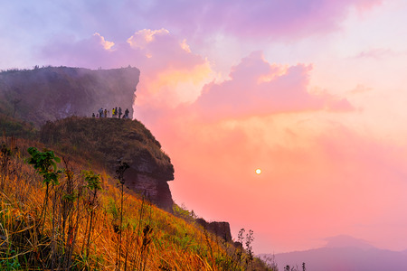 Phu Chi Fah in Chiang Rai,Thailand at sunrise.Phu Chi Fah, is a mountain area and national forest park. it is one of the famous tourist attractions of the Thai highlands near Chiang Rai. Stock Photo