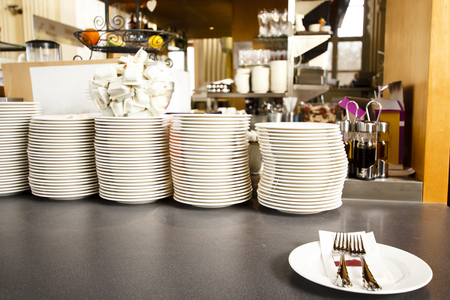 Pile of clean plates in the restaurant photo