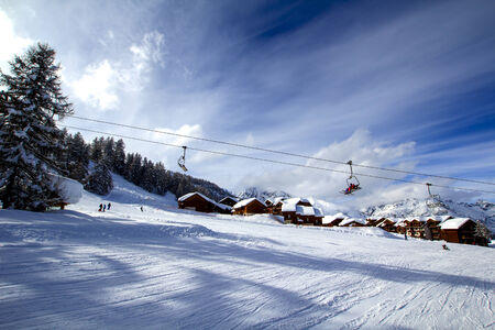 Ski sloap with alpine village on the background photo