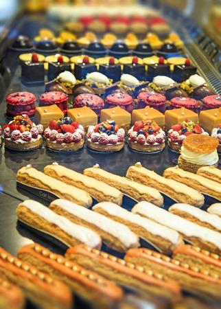 bakery store: Colorful pastiries at food display, Paris, France