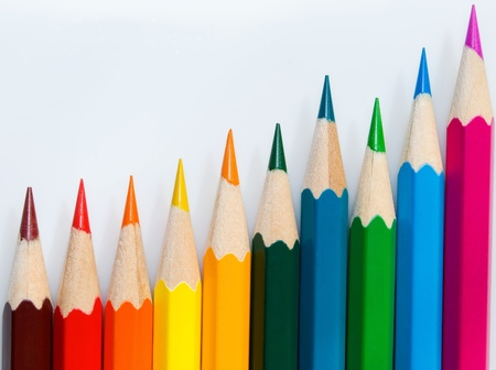 Crayons, close-up, are located vertically, on light background. photo