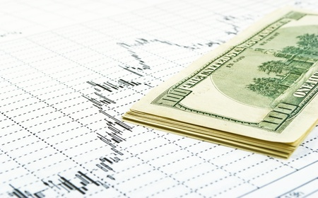 dividends: Several bills, value in 100 dollars, built pack, close-up, on background paper graphics. Stock Photo