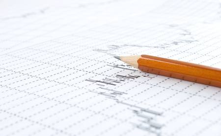 embedding: The pencil close-up, on background of the paper, printouts rising graphics, stock market.