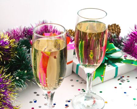 champaign: Two glass goblets, pervaded drink, close-up, on background of the tinsel, boll and other new year
