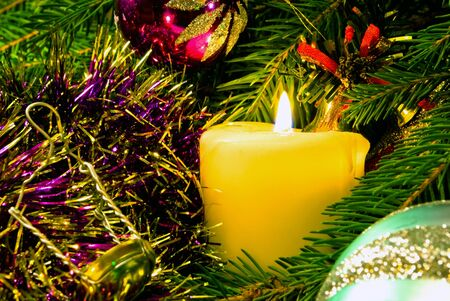 encirclement: The Burninging candle; close-up; in encirclement of the fur branches; new year Stock Photo