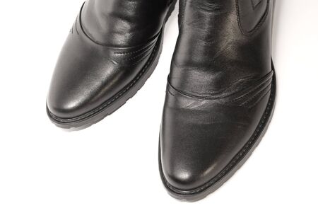 defining: Leather male footwear, close-up, on white background.