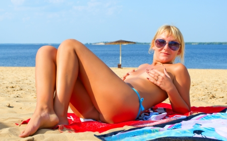 Female topless tanning on the beach  photo