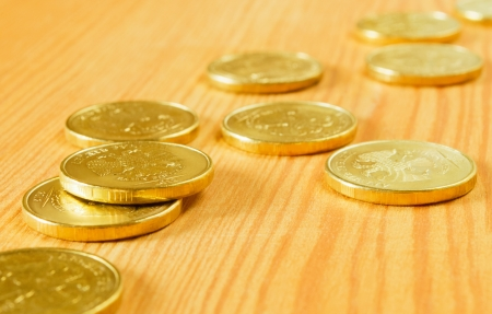 Gold coins of the table, close-up. Stock Photo - 15783717