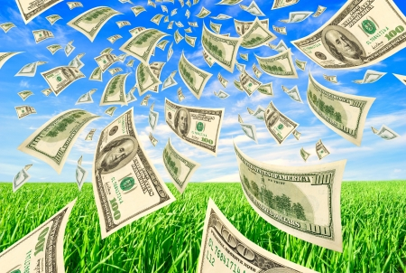 money transfer: Deformed dollars in the sky and grass  Stock Photo