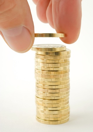 accumulations: Accompaniment of the coin in pile from coins. Stock Photo