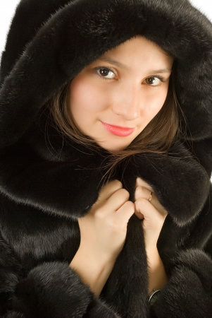 Portrait of a girl beautiful girl in a mink coat. photo