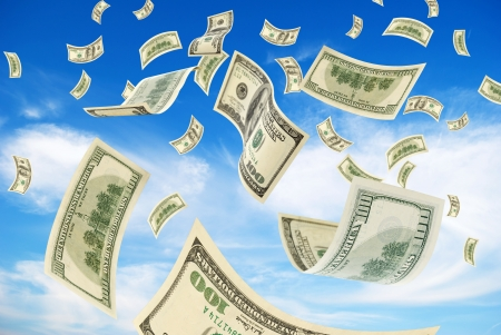 Cash, on 100 dollars, falling with the sky. Stock Photo - 16935855