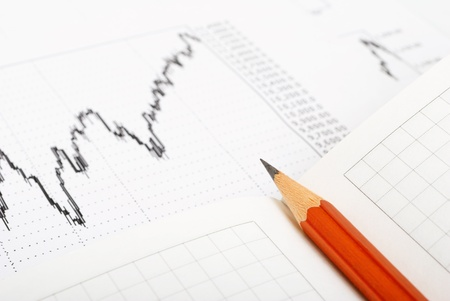 summaries: Graph paper and a pencil on the plane  Stock Photo