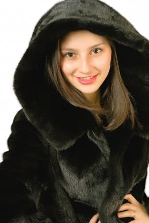 mink: Ragazza in un cappotto di visone su uno sfondo bianco