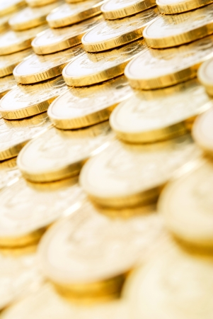 bribes: Coins close-up, vertically. Stock Photo