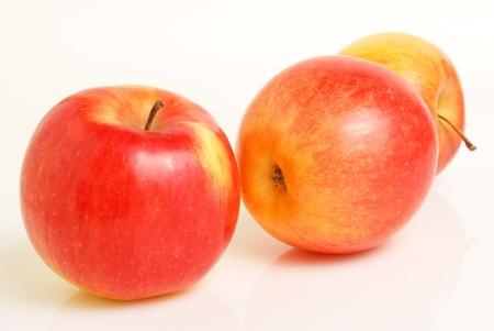 lightup: Three apples on a light-up. Stock Photo