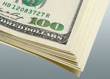 monetization: Fragment packs of dollars on a gray background closeup