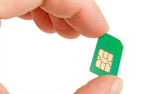 Sim card in a mans hand.