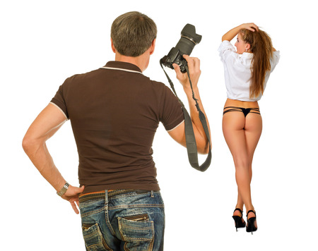 Photographer and model in the process of photographing