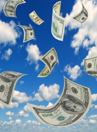 お金は空を飛んでいます。 写真素材