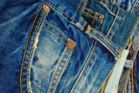 A wide selection of jeans and denim clothing Stok Fotoğraf - 25776518