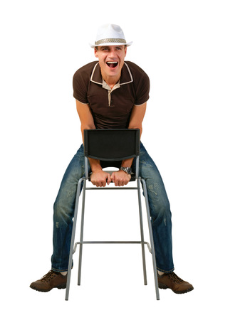 anecdote:  Laughing man on a white sitting on a chair