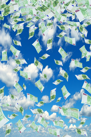 dividends: Deformed euro banknotes in flight on a blue sky
