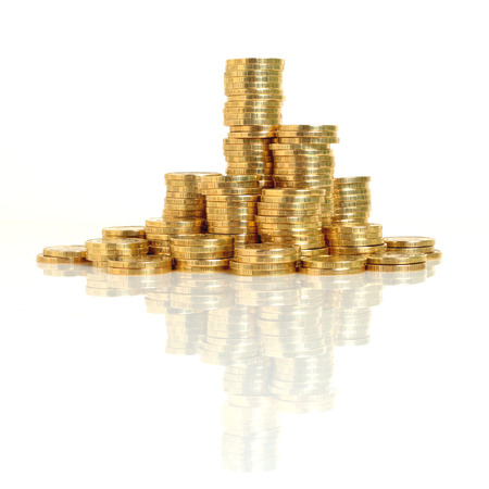monetization: A stack of coins of the yellow metal close-up